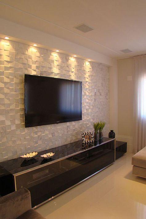 Акцентная стена гостиной выполнена из 3Д гипсовых панелей