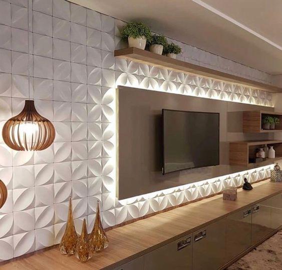 Стена гостиной декорирована 3Д гипсовыми панелями - достойный фон для стенки под телевизор